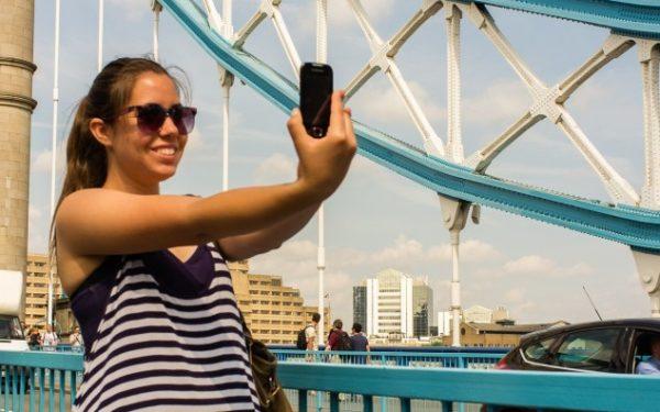 tourist taking selfie in London