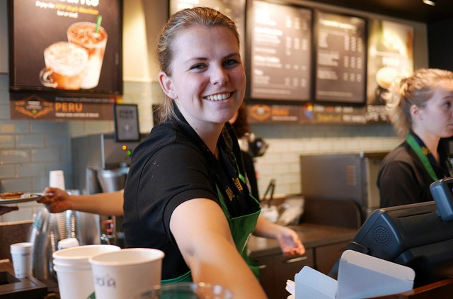 smiling barista at starbucks