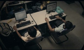 people at computers through lens