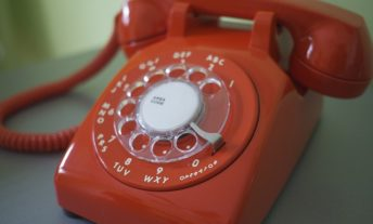 use an old-fashioned telephone to get out of debt
