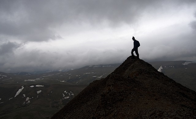 hiker on summit at Denali National Park