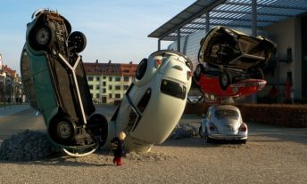 sculpture of a car pile-up - what to do after a car accident