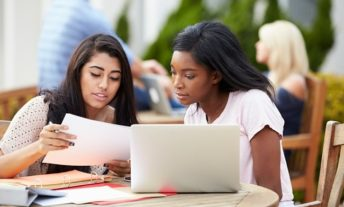students reviewing college financial aid offers