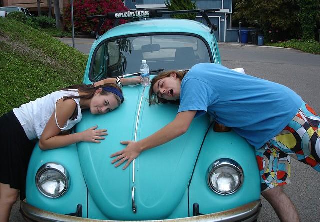 hugging volkswagen beetle