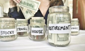 woman putting money into different jars for retirement, stocks, house, etc.