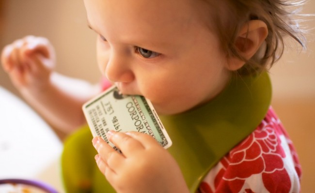 toddler with credit card