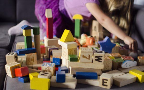 preschool girl playing with blocks - toy rotation