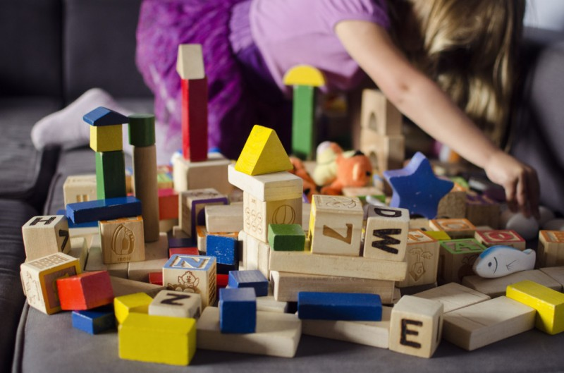 preschool girl playing with blocks - toy rotation