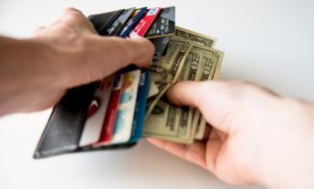 cash and cards in wallet - the best cash back credit cards