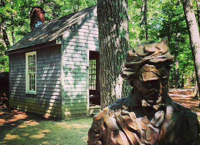 statue of henry david thoreau at walden pond concord