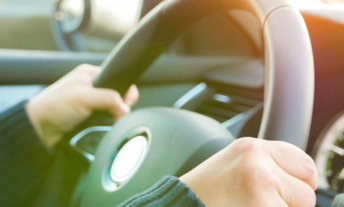 driver behind the wheel of a car - best bad credit car loans