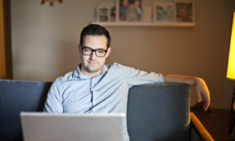 man using laptop - how to open a roth IRA