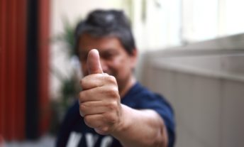 man giving thumbs up of approval - get pre-approved for a credit card