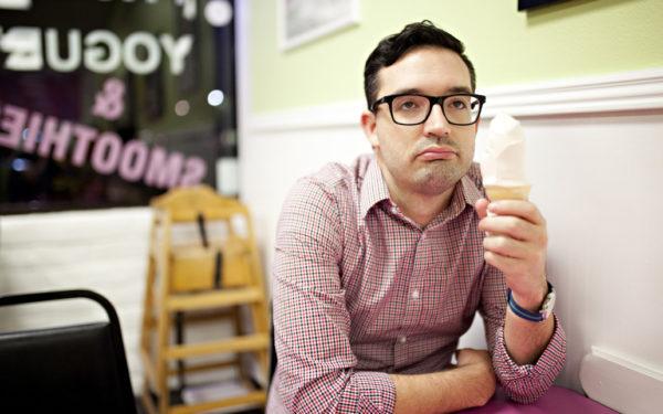 man sadly looking at ice cream