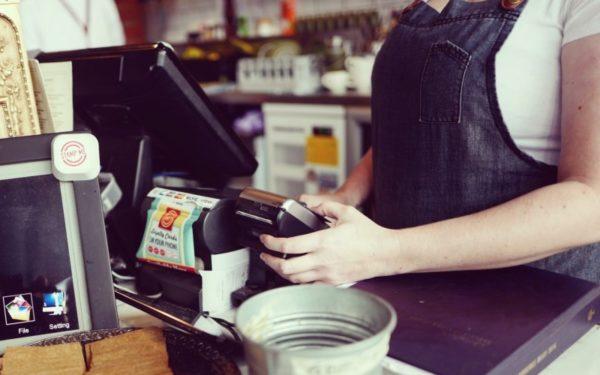 using credit card at cash register - credit card processing fees