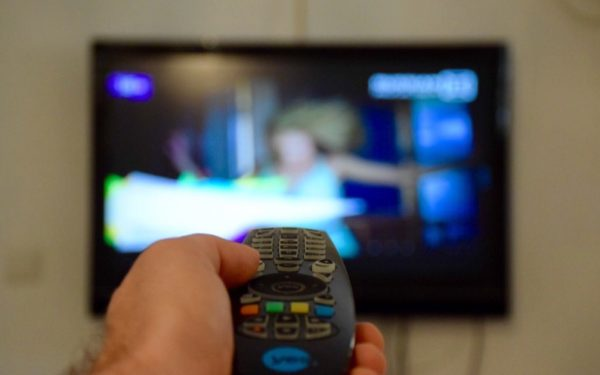 watching tv with remote control