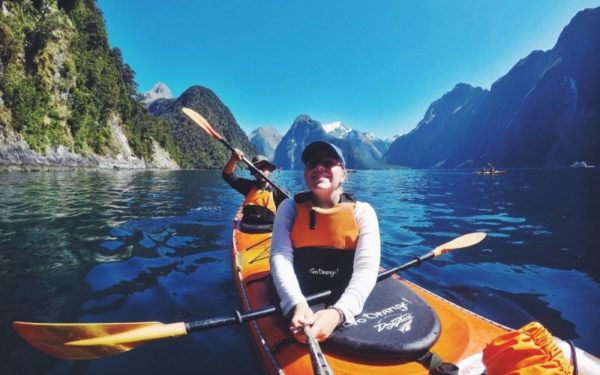 couple kayaking in new zealand - financial independence vs retirement