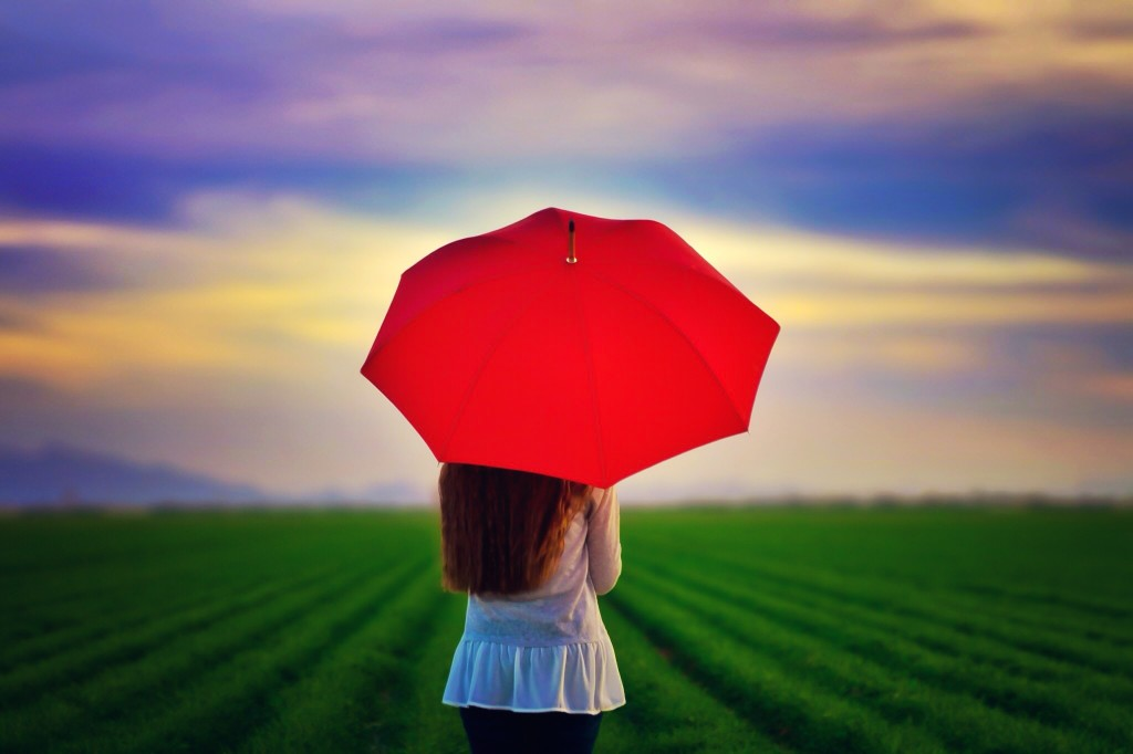 woman with red umbrella - what is umbrella insurance