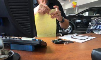 car salesman at car dealership - can you buy a car with a credit card