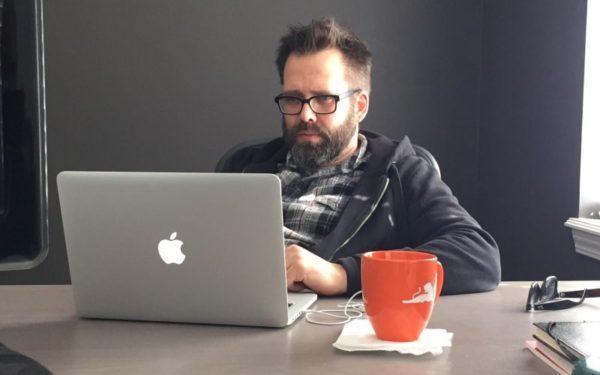 disheveled man working on computer - lying on resume