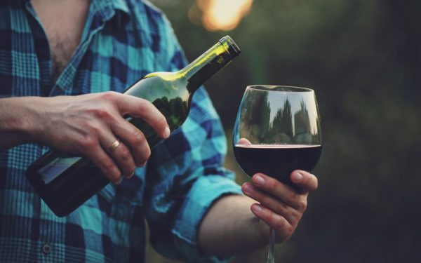 pouring glass of wine at a winery - how to ship wine