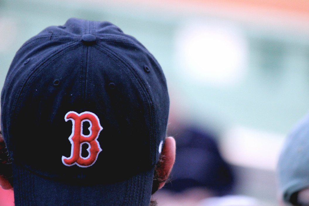 fan in boston red sox hat - how to watch baseball without cable tv