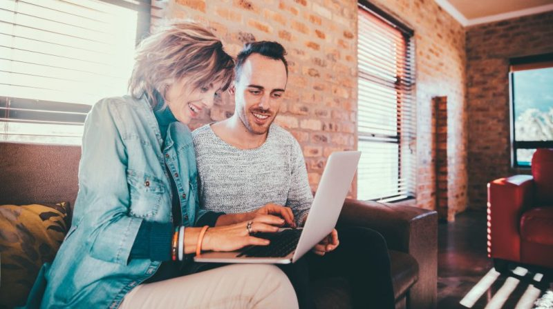 man and woman using laptop - apply for credit card with cosigner