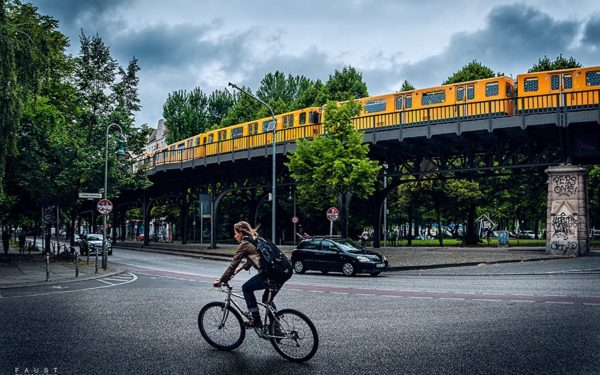 bicyclist, train, and car