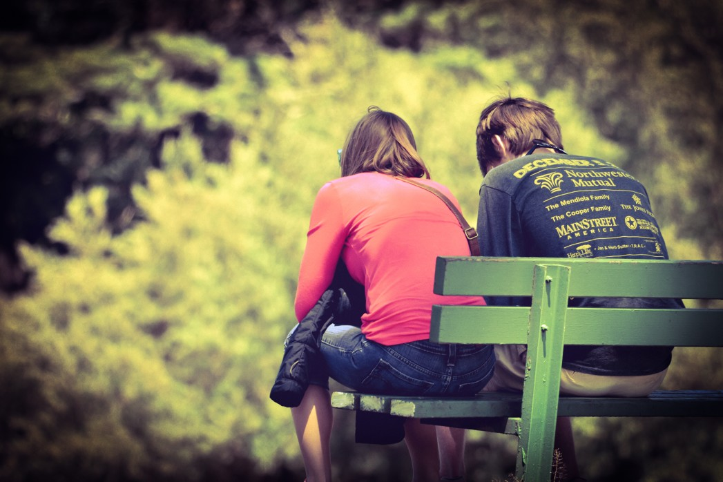 couple on a park bench - does health insurance cover therapy