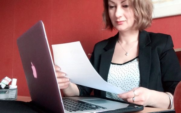 woman reading a debt collection letter