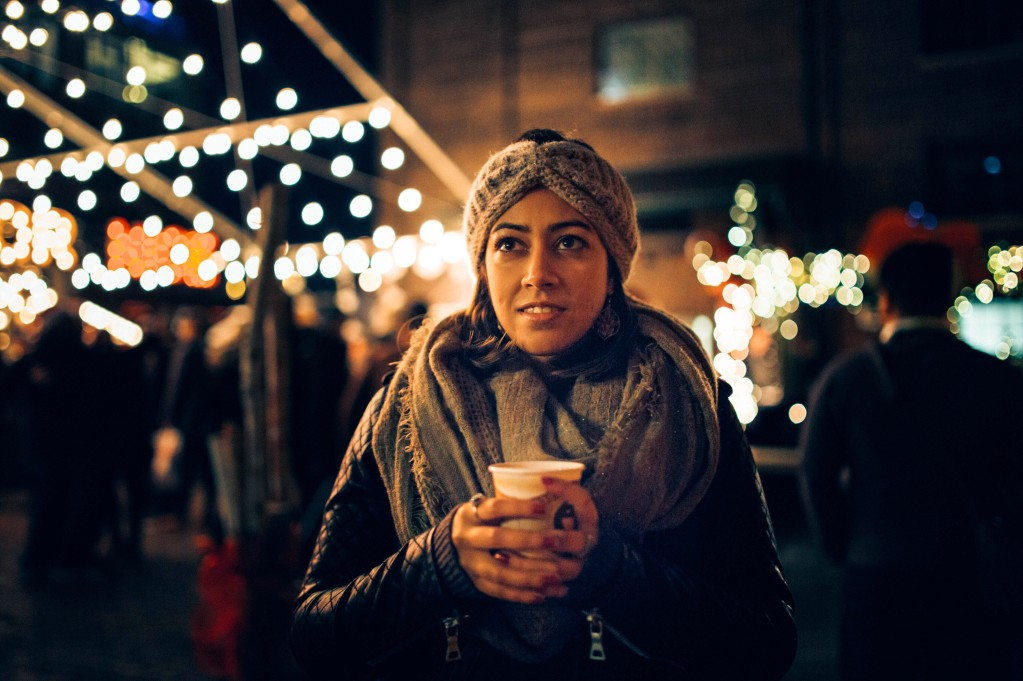 woman and holiday lights