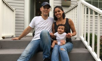 family on the steps of new home - credit score mortgage