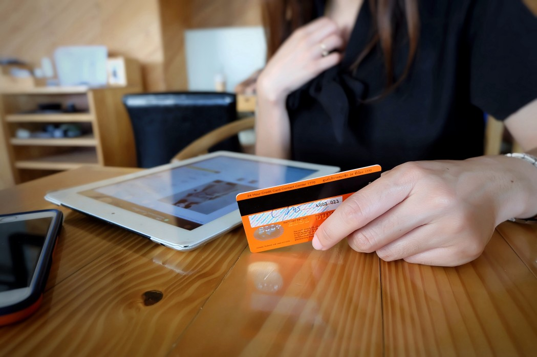woman with credit card - secured business credit card