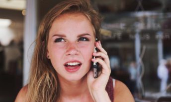 young woman on phone - confusion over debt collection accounts