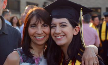 mom and college student at graduation - direct plus loan program and parent plus loan