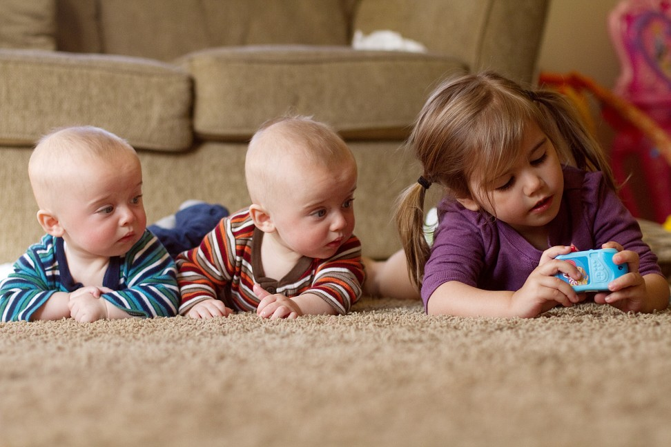 three children on the floor