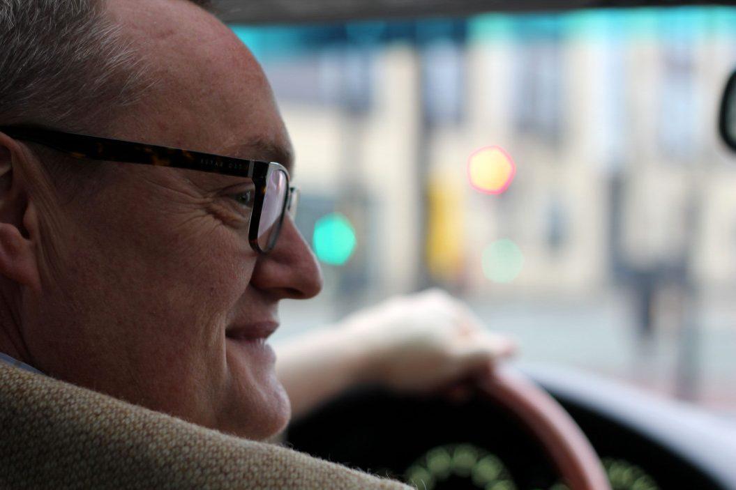 older man driving car insurance for seniors