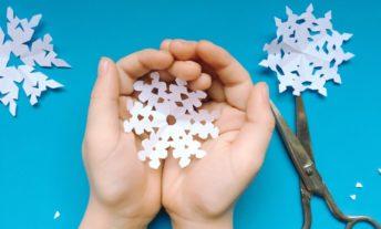 scissors cut a snowflake