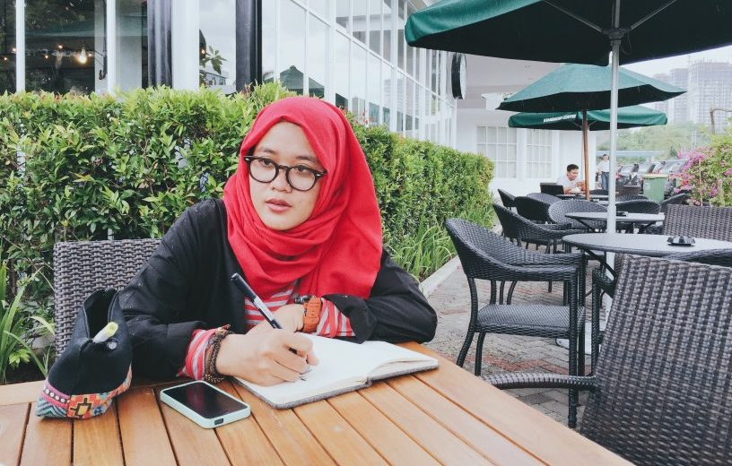 woman studying at cafe - scholarships for women scholarships for moms