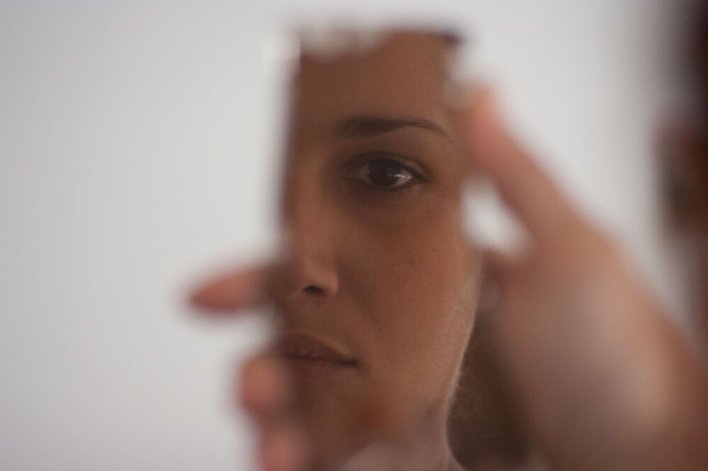 woman's reflection in mirror