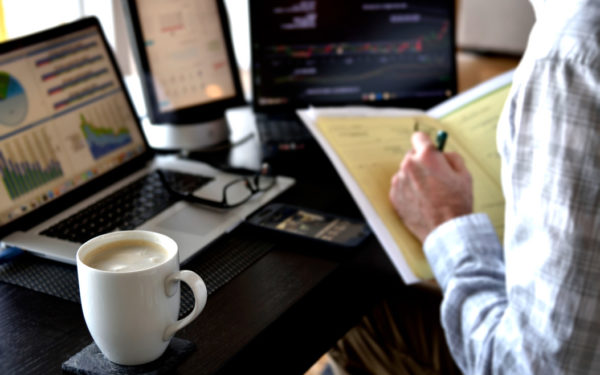 man reviewing investments stocks mutual funds expense ratio