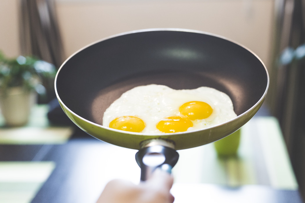 frying eggs in a pan