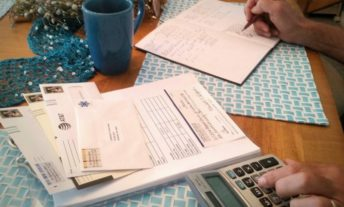 paying bills with calculator - habits of people with great credit