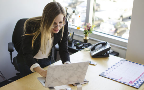 woman at work looking for financial advisor online