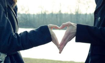 hands making heart shape - planning an affordable wedding