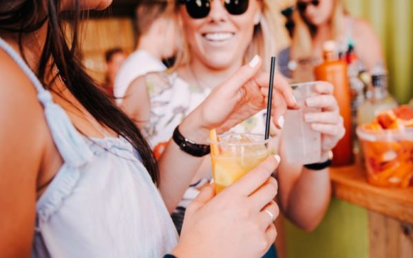 friends drinking cocktails at a bar