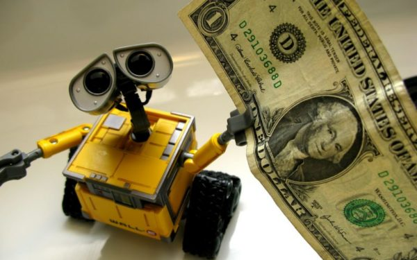 robot holding money - robo advisors and robo investing pros and cons