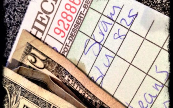 cash and restaurant bill