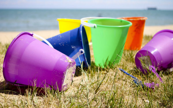 toy buckets at the beach - family vacation