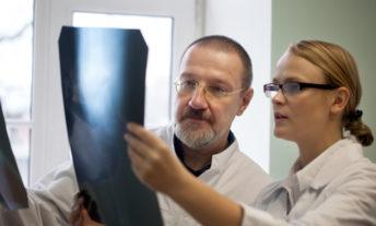 doctors examining x-rays - comparing health savings accounts